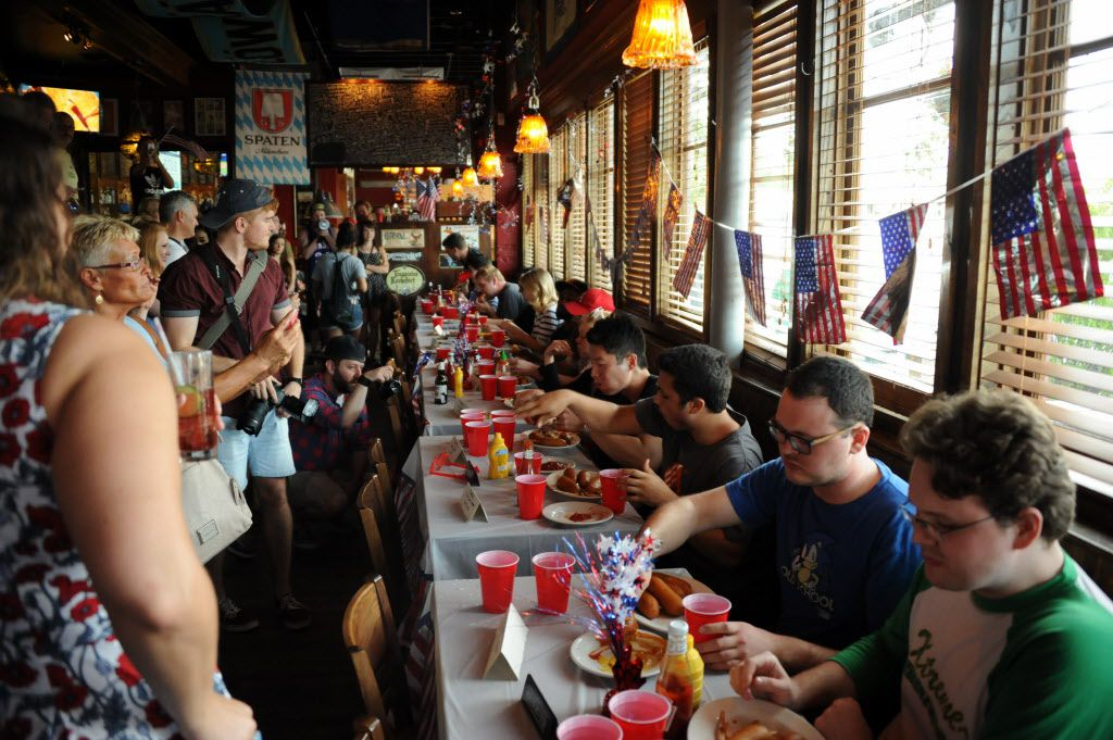 Contestants participate in the 7th annual Brass Knuckles Corn Dog Beatdown at The Libertine Bar on July 4, 2015.