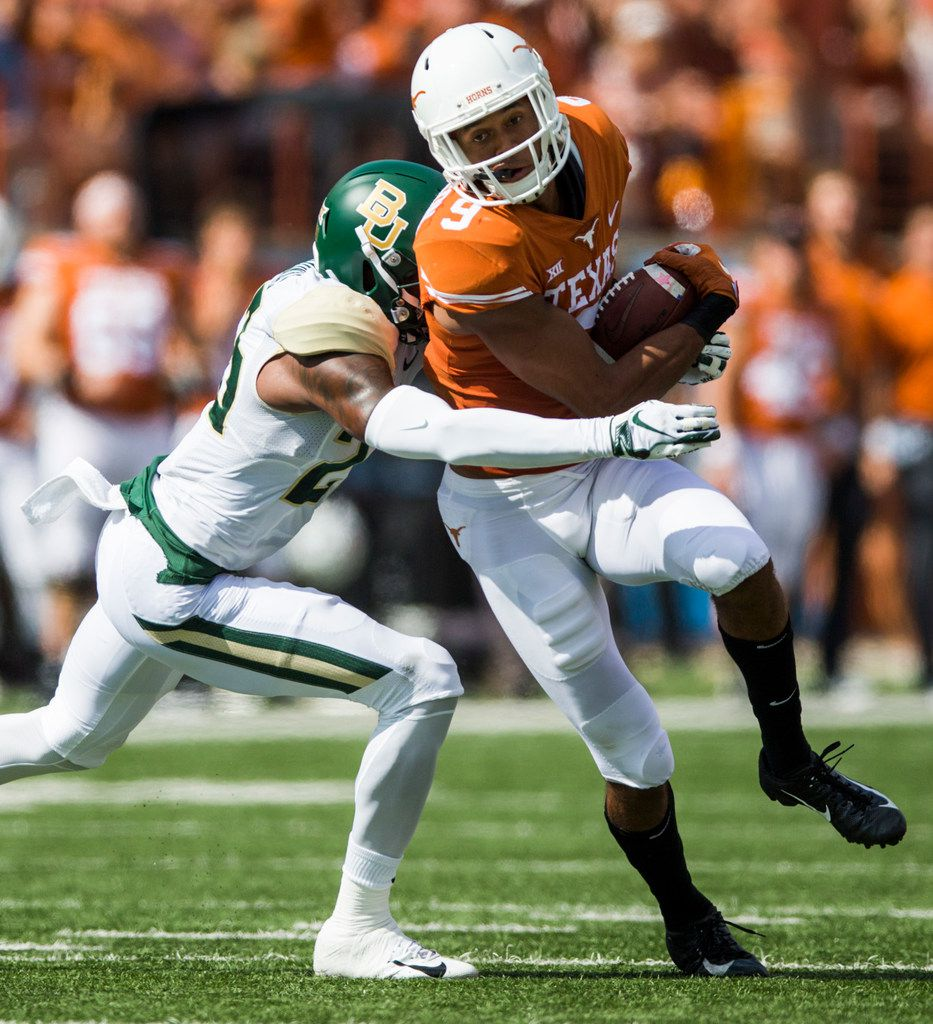 Texas Longhorns wide receiver Collin Johnson (9) is tackled by Baylor Bears cornerback Derrek Thomas (23) during the first quarter of a college football game between Baylor and the University of Texas on Saturday, October 13, 2018 at Darrell K Royal Memorial Stadium in Austin, Texas.  (Ashley Landis/The Dallas Morning News)