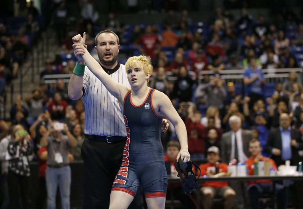 Euless Trinity's Mack Beggs is announced as the winner of the state championship title in the girls Class 6A girls 110 weight class during the UIL Wrestling State Tournament at Berry Center in Cypress on Saturday, February 25, 2017. Beggs, a 17-year-old transgender wrestler from Euless Trinity making a transition from female to male, defeated Katy Morton Ranch's Chelsea Sanchez.  (Vernon Bryant/The Dallas Morning News)