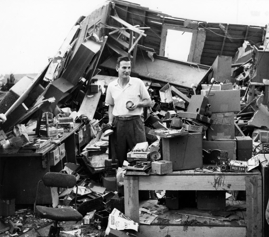 A homeowner picks up the pieces days after the 1957 tornado in Dallas.