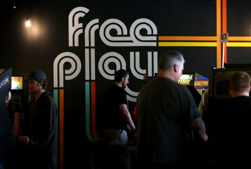 People play video games at Free Play in Richardson, Texas on Saturday, Aug. 11, 2018.