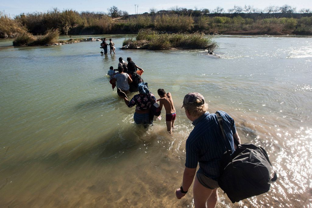 Migrants cross the border into the U.S. from Mexico near the Texas city of Eagle Pass.