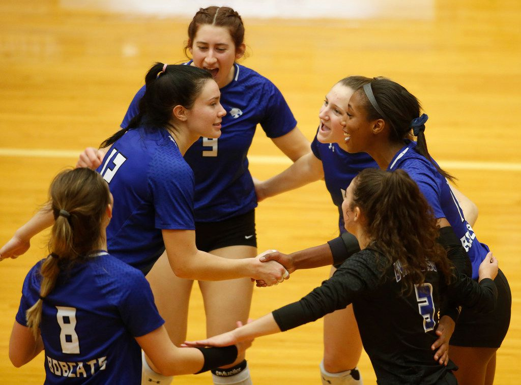 Trophy Club Byron Nelson's Payton Chamberlain (12), left, receives congratulations following a score during the first game of their match against Denton Guyer. Pictured with Chamberlain are teammates (from top left to right) are Styler McKinnon (9), Eden Fusselman (1), Charitie Luper (10), Gia Santini (3) and Paige Flickinger (8). Byron Nelson prevailed, 25-18, 25-17, 25-16 to advance to the state tournament.  The two teams played their Class 6A Region l championship volleyball match at W.G. Thomas Coliseum in Haltom City on November 16, 2019. (Steve Hamm/ Special Contributor)