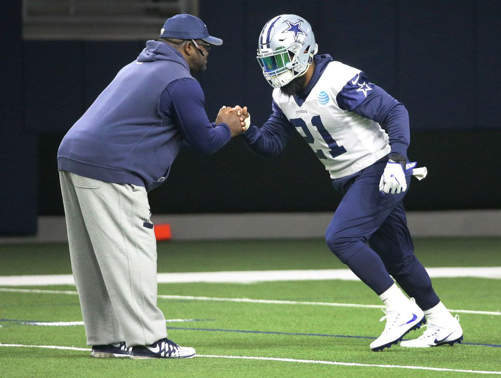 Dallas Cowboys running back Ezekiel Elliott (21) works with running backs coach Gary Brown at the Star in Frisco, Texas on Friday, November 3, 2017. (Louis DeLuca/The Dallas Morning News)