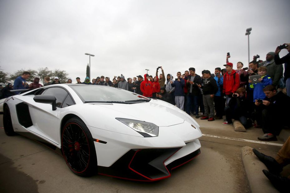 Car aficionados snap photos of a Lamborghini Aventador Superveloce LP-790 during a February 2016 Cars and Coffee meetup at Classic BMW in Plano.