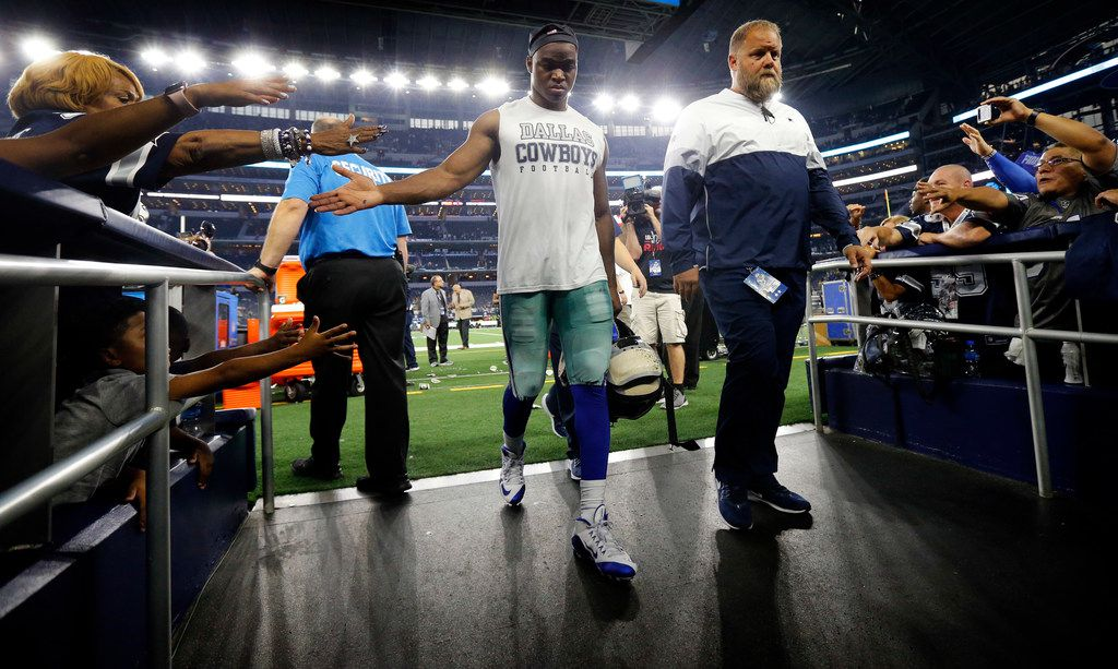 Dallas Cowboys wide receiver Amari Cooper (center) walks off the field after their 34-24 loss to the Green Bay Packers at AT&T Stadium in Arlington, Texas, Sunday, October 6, 2019. (Tom Fox/The Dallas Morning News)