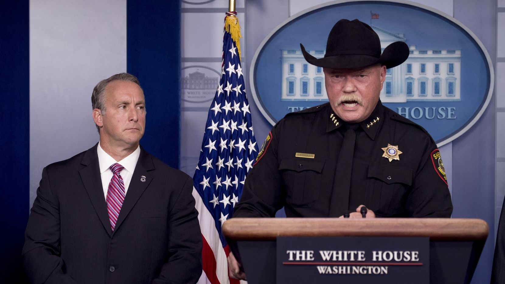 Tarrant County Sheriff Bill Waybourn, with acting Immigration and Customs Enforcement Director Matt Albence, left, speaks in the White House Briefing Room on Thursday, Oct. 10, 2019. (AP Photo/Andrew Harnik)