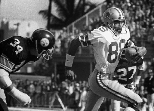FILE - Dallas Cowboys wide receiver Drew  Pearson (88, right) eludes Pittsburgh Steelers defender Andy  Russell (34) in route to the Cowboys' first score in Super Bowl X  in Miami.