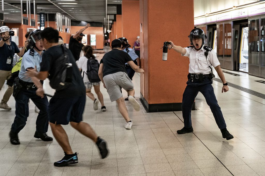 A police officer holds up pepper spray as he attempts to disperse protesters out of the platform at Po Lam Station on Sept. 5, 2019 in Hong Kong. Pro-democracy protesters have continued demonstrations across Hong Kong since 9 June against a controversial bill which allows extraditions to mainland China, as the ongoing protests, many ending up in violent clashes with the police, have surpassed the Umbrella Movement from five years ago and become the biggest political crisis since Britain handed its onetime colony back to China in 1997.