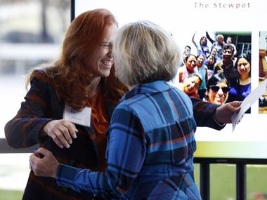 Brenda Snitzer of The Stewpot of First Presbyterian Church hugs Camille Grimes (right), executive director of The Dallas Morning News Charities after receiving a check during The Dallas Morning News Charities 2019-20 Campaign Kickoff Reception at Winspear Opera House in Dallas, on Thursday, Nov. 14, 2019.