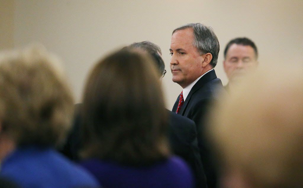 Texas Attorney General Ken Paxton, shown leaving court at the conclusion of his hearing on his felony securities indictment in August 2015. The prosecutors pursuing criminal charges against him have been fighting a related suit seeking immediate payment for the years of work they've spent on the case.