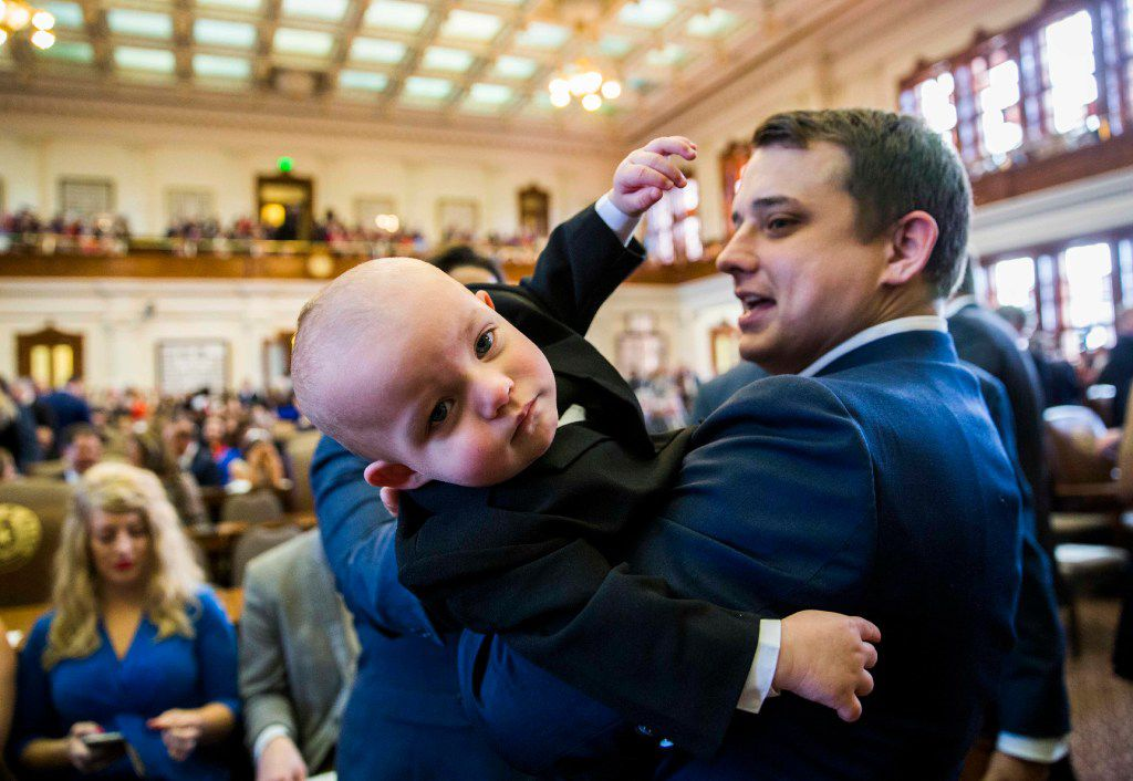 Texas State Representative Brisco Cain wrangles his son, Crockett Cain, 13 months, during the first day of the 85th Texas Legislative Session on Tuesday, January 10, 2017 at the Texas State Capitol in Austin, Texas. (Ashley Landis/The Dallas Morning News)