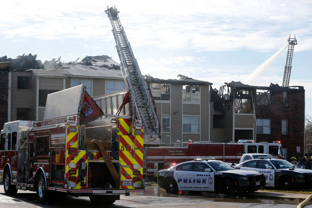 Fire crews were working at the scene of an apartment fire at the Meadows at Ferguson at the intersection of I-635 and Ferguson Road in Dallas on Nov. 21, 2018.