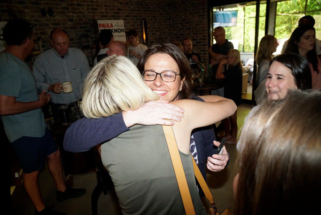 Paula Blackmon hugs Katie Sauce during her runoff watch party at Local Traveler in Dallas, TX on Saturday, June 8, 2019.