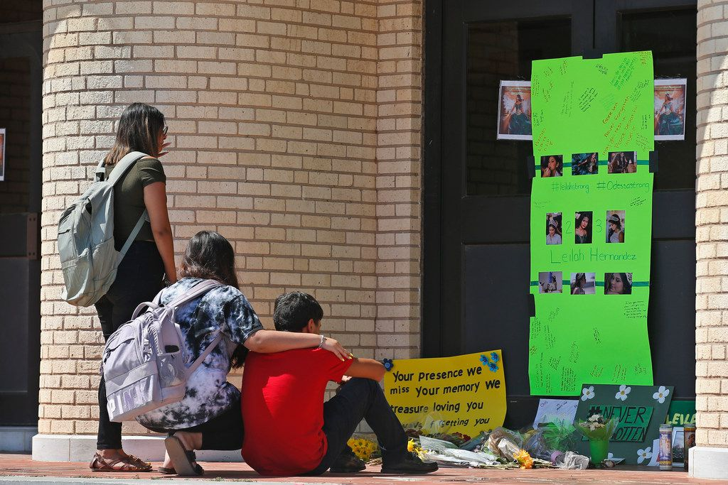 In this Sept. 3, 2019 photo, people gather at a memorial for slain high school student Leilah Hernandez at Odessa High School. Hernandez was a victim of a mass shooting on Aug. 31. School district officials say they're putting the finishing touches on how they'll mark the tragedy both at the Permian game on Thursday and intracity rival Odessa High School's game on Friday.