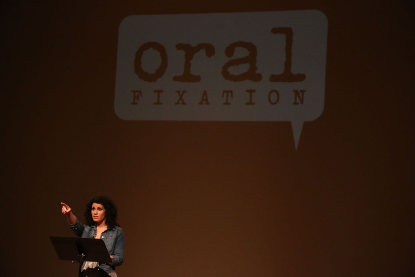 """Monica Berry performed her story """"Go with the Flow""""€ at Oral Fixation's """"The Best of Season Four"""" at the Dallas Museum of Art on August 15, 2015"""