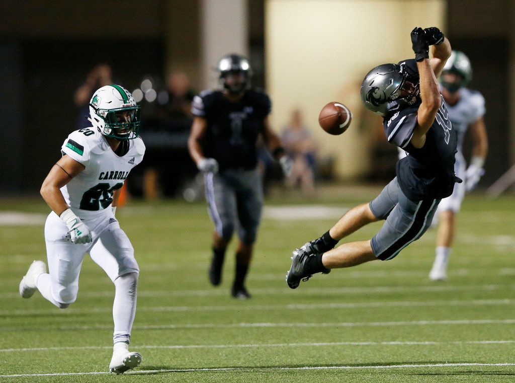 Denton Guyer's Seth Meador (19) can't make the catch as Southlake Carroll's James Miscoll (20) closes in on the play during the first half of play at C.H. Collins Complex in Denton, on Friday, October 4, 2019. (Vernon Bryant/The Dallas Morning News)