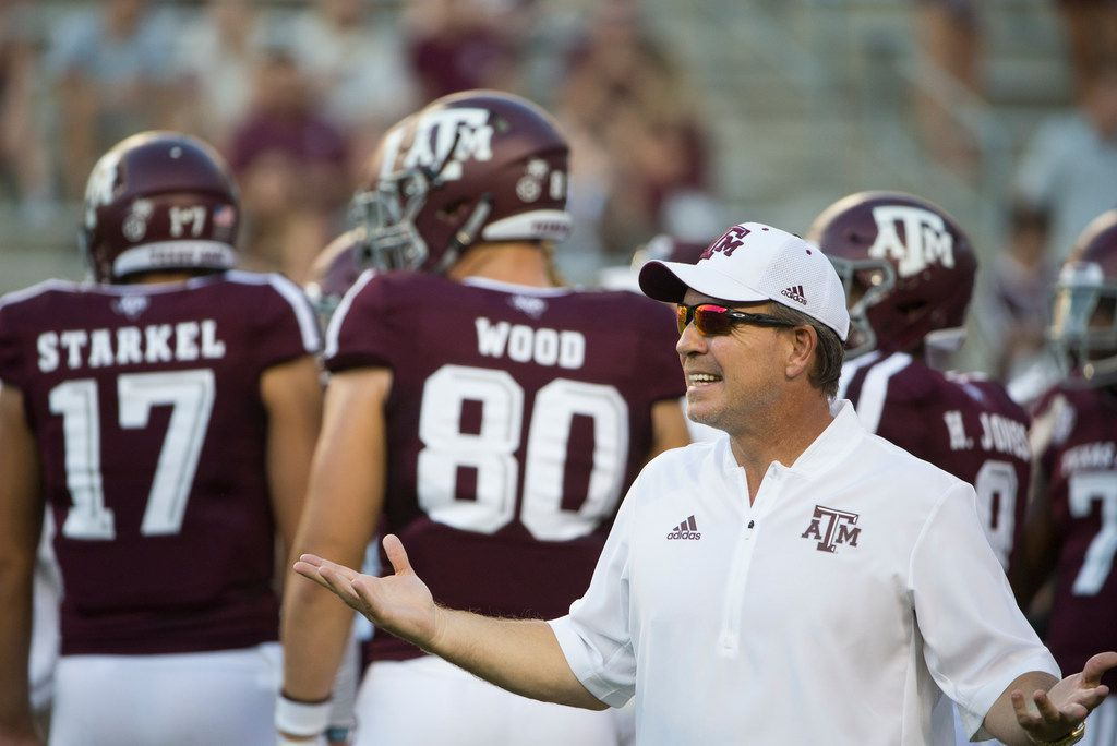 Texas A&M Aggies head coach Jimbo Fisher works with players during warmups prior to a matchup between the Texas A&M Aggies and the Northwestern State Demons on Thursday, August 30, 2018 at Kyle Field in College Station, Texas. (Ryan Michalesko/The Dallas Morning News)