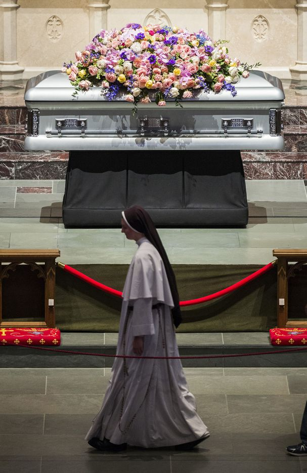 A nun walks past the casket of former first lady Barbara Bush on Friday, April 20, 2018 at St. Martin's Episcopal Church in Houston. Bush died on Tuesday and her funeral services are on Saturday. (Ashley Landis/The Dallas Morning News)