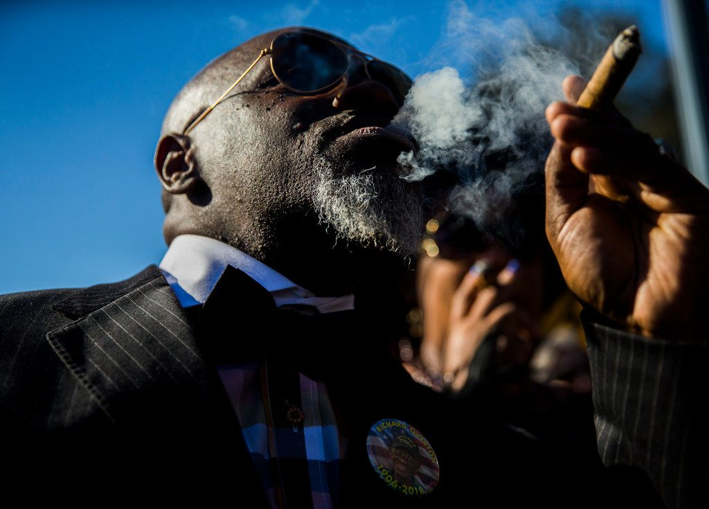 Brian Gregg smokes a cigar in honor of Richard Overton during a graveside service on Saturday, Jan. 12, 2019, in Austin. Overton was the oldest living veteran and oldest living male at 112 years old until he died on Dec. 27, 2018. He was known for drinking whiskey and smoking cigars on his front porch in East Austin.