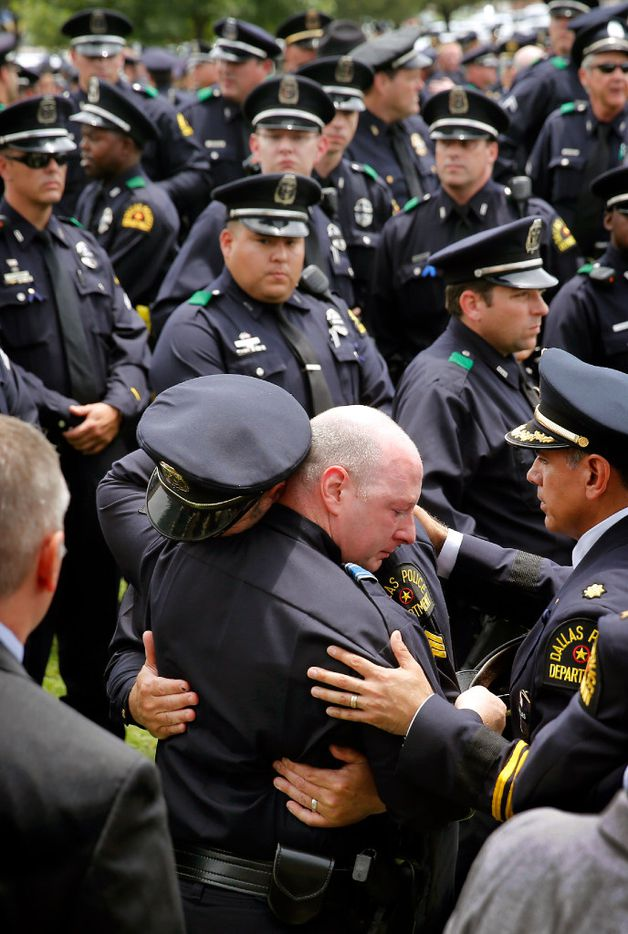 Dallas police officer comfort one another following the police Honor Guard Ceremony for officer Michael Krol outside of Prestonwood Baptist Church in Plano, Texas, Friday, July 15, 2016. Krol was gunned down in an ambush attack in downtown Dallas a week ago. Four Dallas police officers and one DART officer were killed and several survived. (Tom Fox/The Dallas Morning News, pool photo)