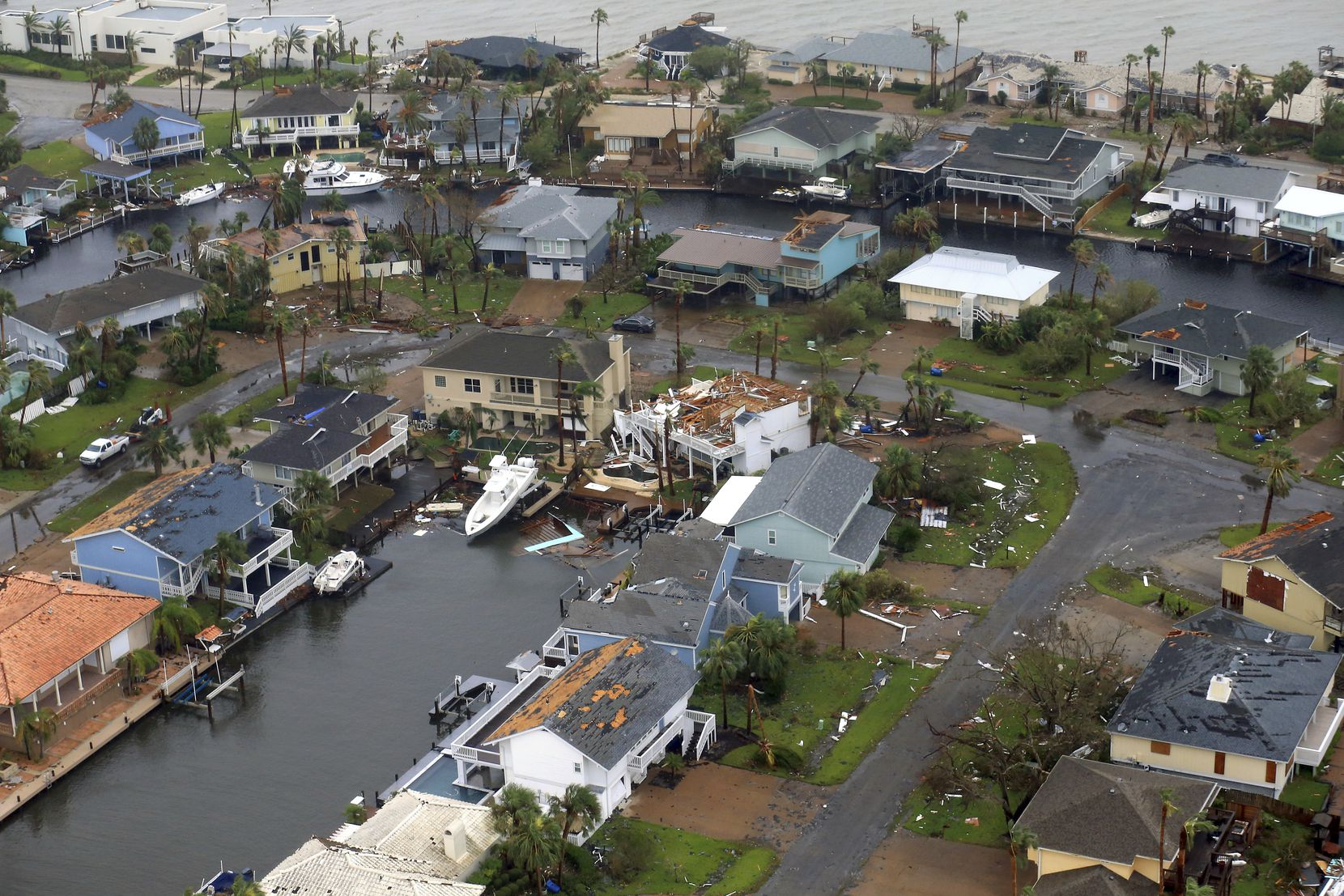This aerial photo shows a view of damage in the wake of Hurricane Harvey, Monday, Aug. 28, 2017, in Corpus Christi, Texas. Harvey hit the coast as a Category 4 hurricane. (Gabe Hernandez/Corpus Christi Caller-Times via AP)