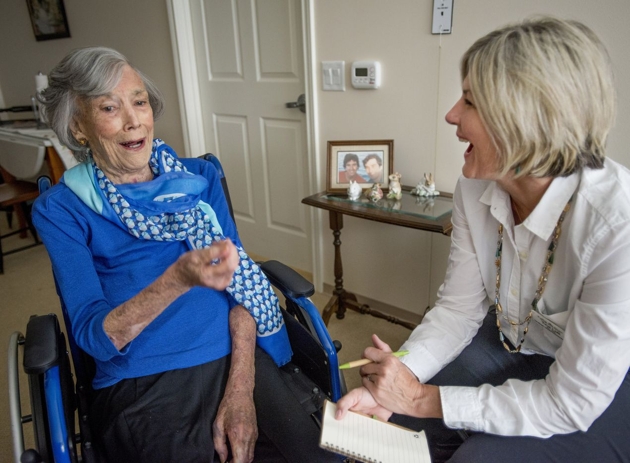 Judith Holbrook, left, a resident at Belmont Village in Dallas, Texas, talks with Tina Lott from Caring With Grace in Holbrookís room on June 6, 2018.