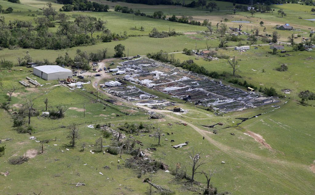 Damaged greenhouses and trees are seen from the air after severe storms including tornadoes swept through several small towns in East Texas yesterday on Sunday, April 30, 2017.