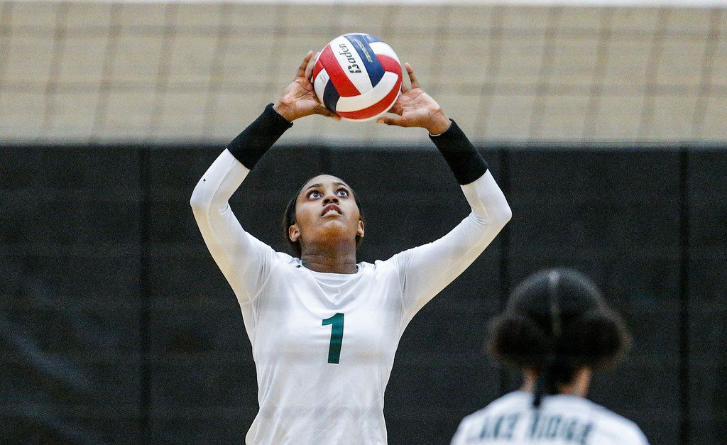 Mansfield Lake Ridge senior Madison Williams (1) sets the ball during a high school volleyball game against North Mesquite at Mansfield Lake Ridge High school in Mansfield, Tuesday, August 27, 2019. Lake Ridge won in three sets. (Brandon Wade/Special Contributor)