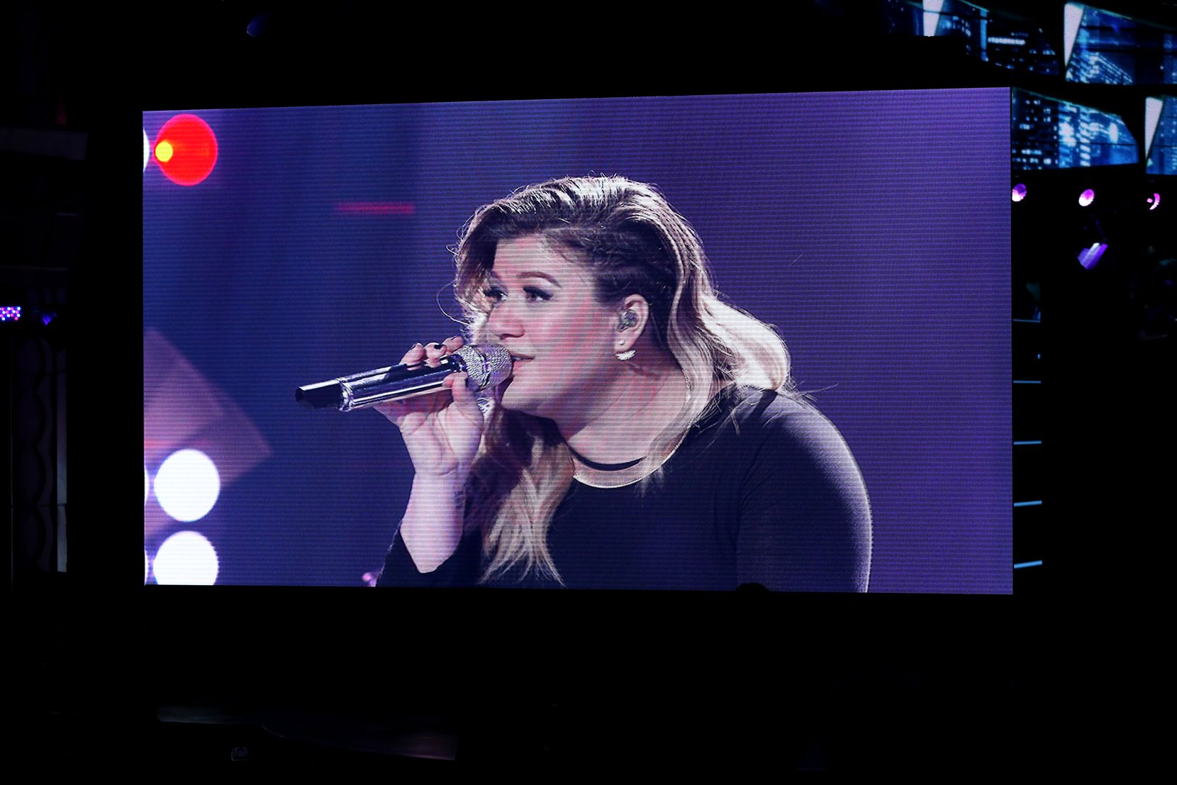 "Kelly Clarkson performs remotely during the ""American Idol"" farewell season finale at the Dolby Theatre on Thursday, April 7, 2016, in Los Angeles."