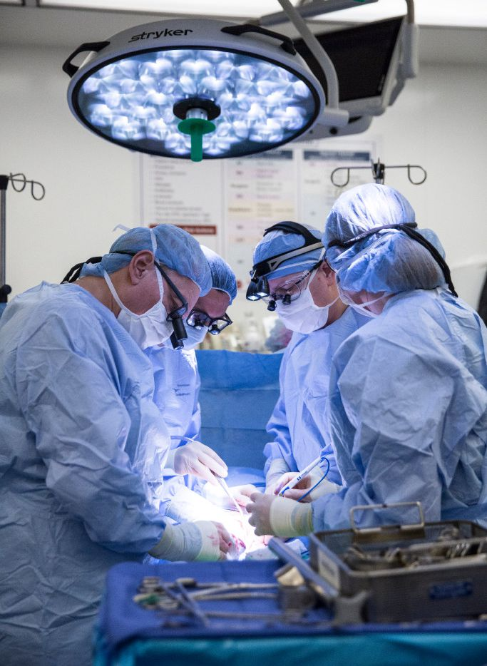 Surgeons at Baylor University Medical Center in Dallas performing the first uterine transplant from a live donor in the U.S. on Sept. 14. From left to right, the surgeons include Dr. Greg McKenna, Dr. Giuliano Testa, Dr. E. Colin Koon and Dr. Liza Johannesson