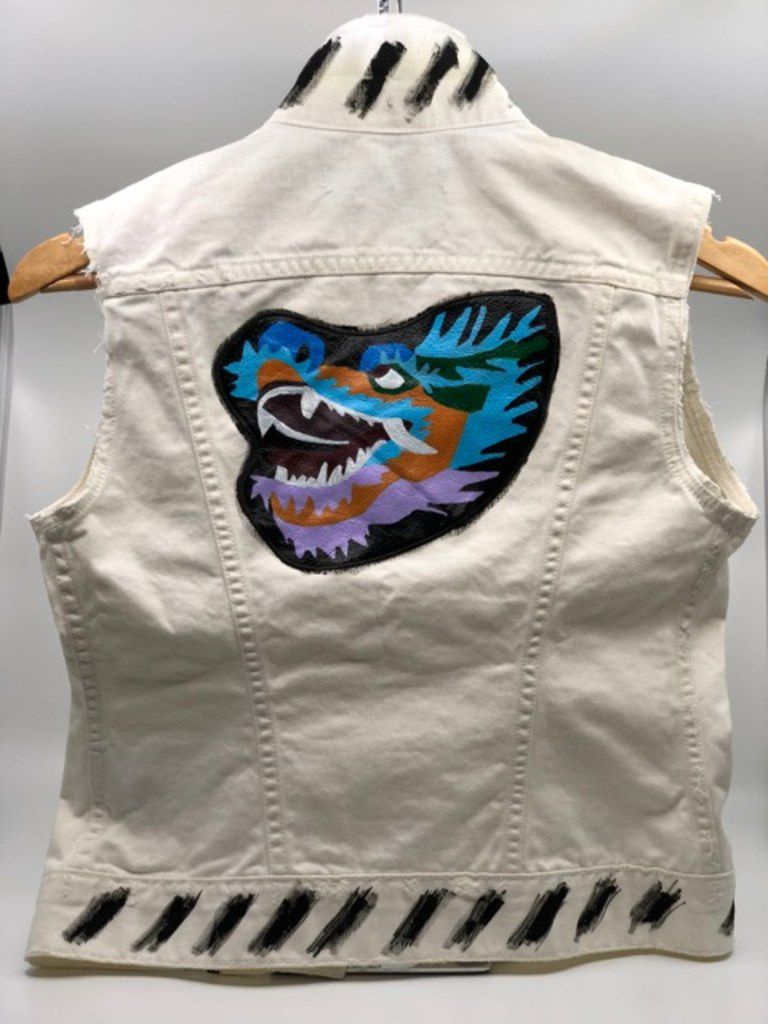 Stephanie Quadri had KCA Design paint a dragon on her denim vest in honor of her son.