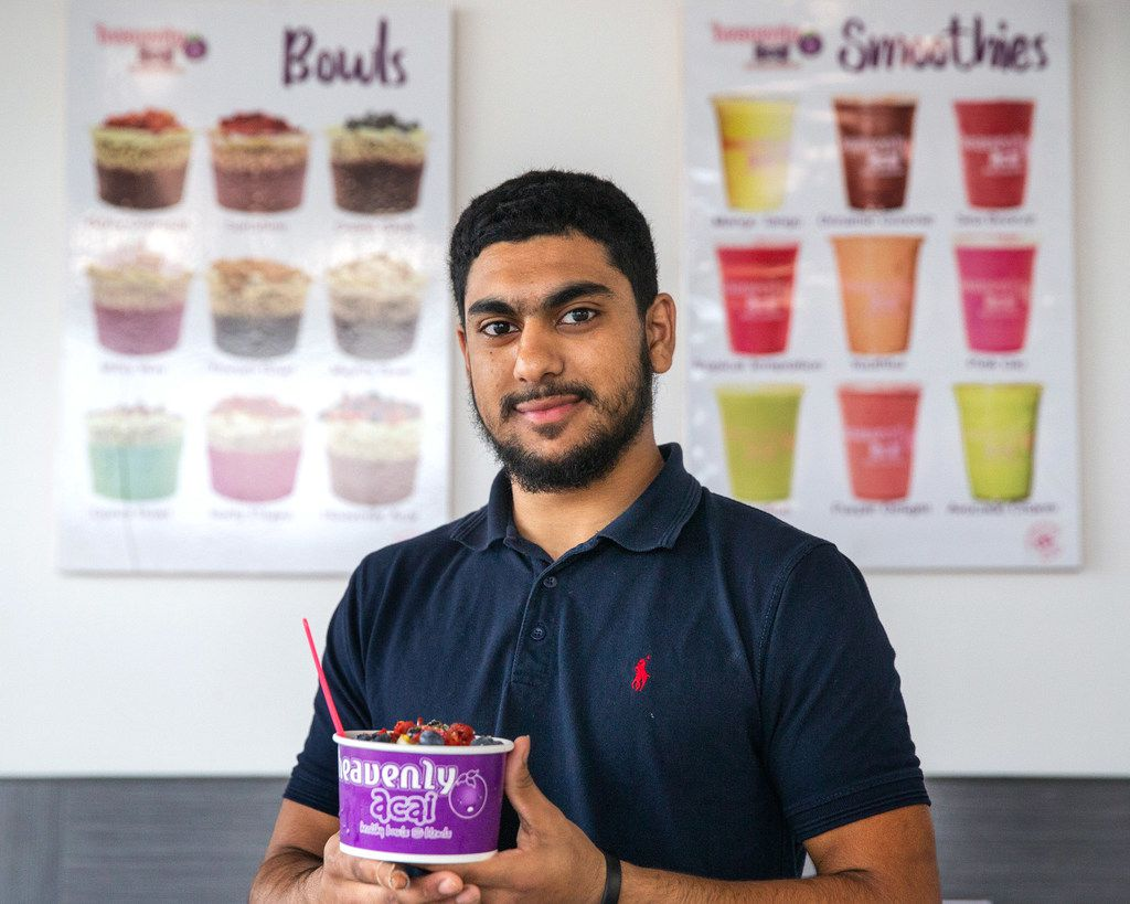 Talha Ali, owner of Heavenly Acai in Frisco poses for a portrait at the cafe . (Lynda M. Gonzalez/The Dallas Morning News)