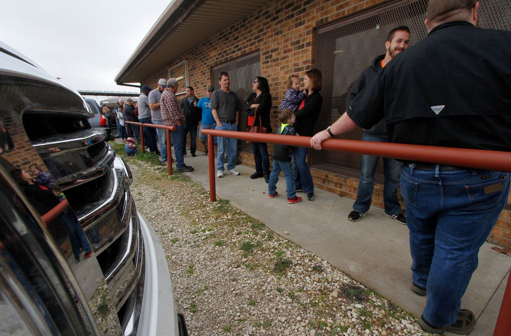 Loyal supporters of Flores Barbecue wait in a long line for the restaurant to open during their final weekend in business before moving the company to Tarrant County. The popular restaurant is moving to Fort Worth where they will initially re-open the business before moving into a true restaurant in the early summer of 2020. Pitmaster and owner Michael Wyont and his staff served loyal customers at Flores Barbecue in Whitney during their final weekend of business. Some of his loyal customers waited up to an hour in line for his famous barbecue and share their well wishes on Saturday February 2, 2019 (Steve Hamm/ Special Contributor)