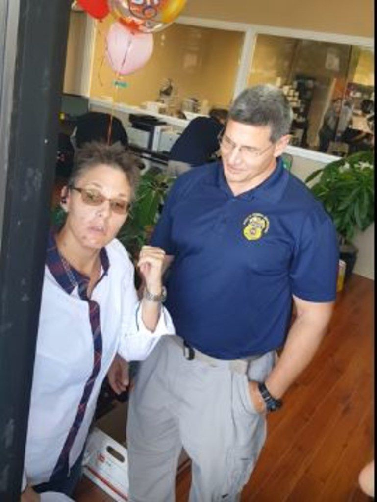 Tamara Mitchell argues with federal agents executing a search warrant at her pharmacy.