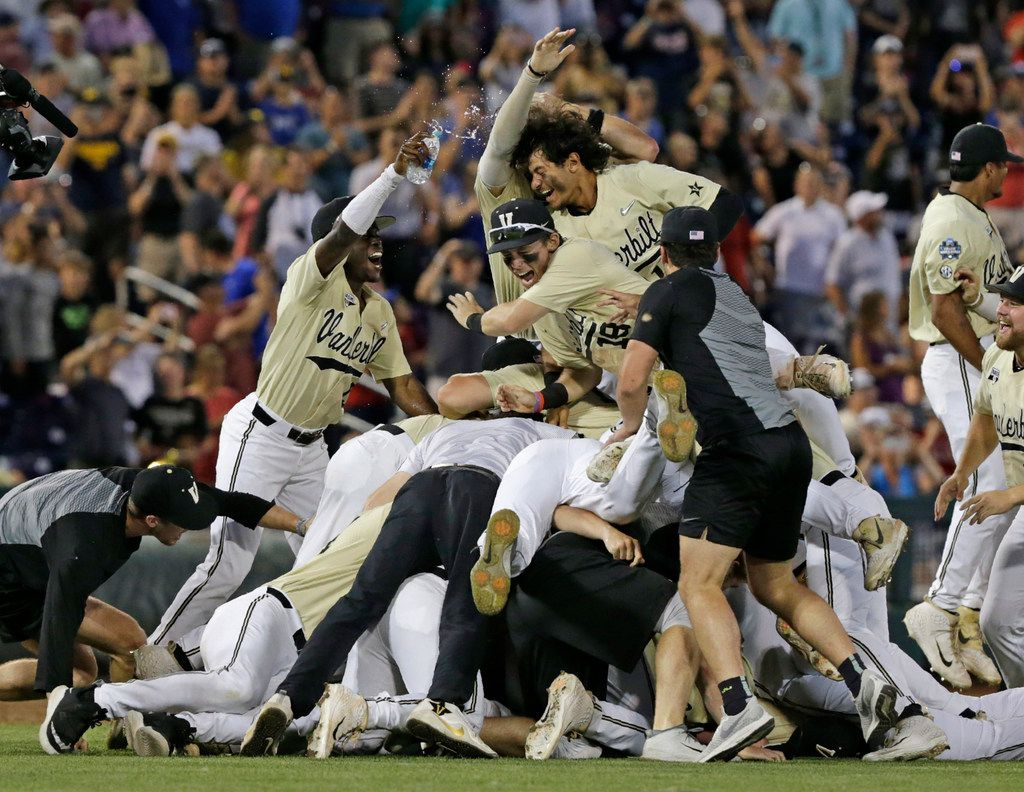 Vanderbilt players celebrate after defeating Michigan to win Game 3 of the NCAA College World Series baseball finals in Omaha, Neb., Wednesday, June 26, 2019. (AP Photo/Nati Harnik)