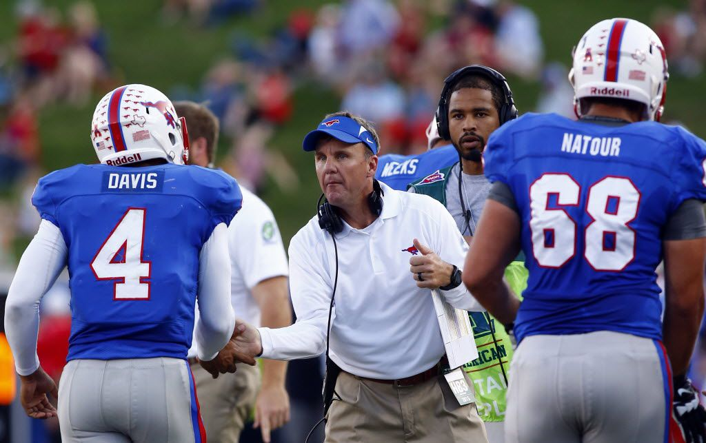SMU head coach Chad Morris welcomes SMU quarterback Matt Davis (4)  and offensive lineman Nick Natour (68) to the sideline after an offensive possession against James Madison in the first half of their college football game at Gerald J. Ford Stadium in Dallas, Texas, Saturday, September 26, 2015. Garland defeated Sachse 38-34.  Mike Stone/Special Contributor