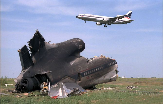 A plane flew near the wreckage of Delta Flight 191 in 1985 at D/FW. Because of that crash, most large airports now have low-level wind-shear alert systems.