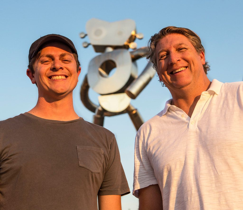 Brandon Oldenburg and Brad Oldham were  the artists behind the making of the three-part sculpture series in Deep Ellum. Behind them is the friendly face of The Traveling Man — Walking Tall.