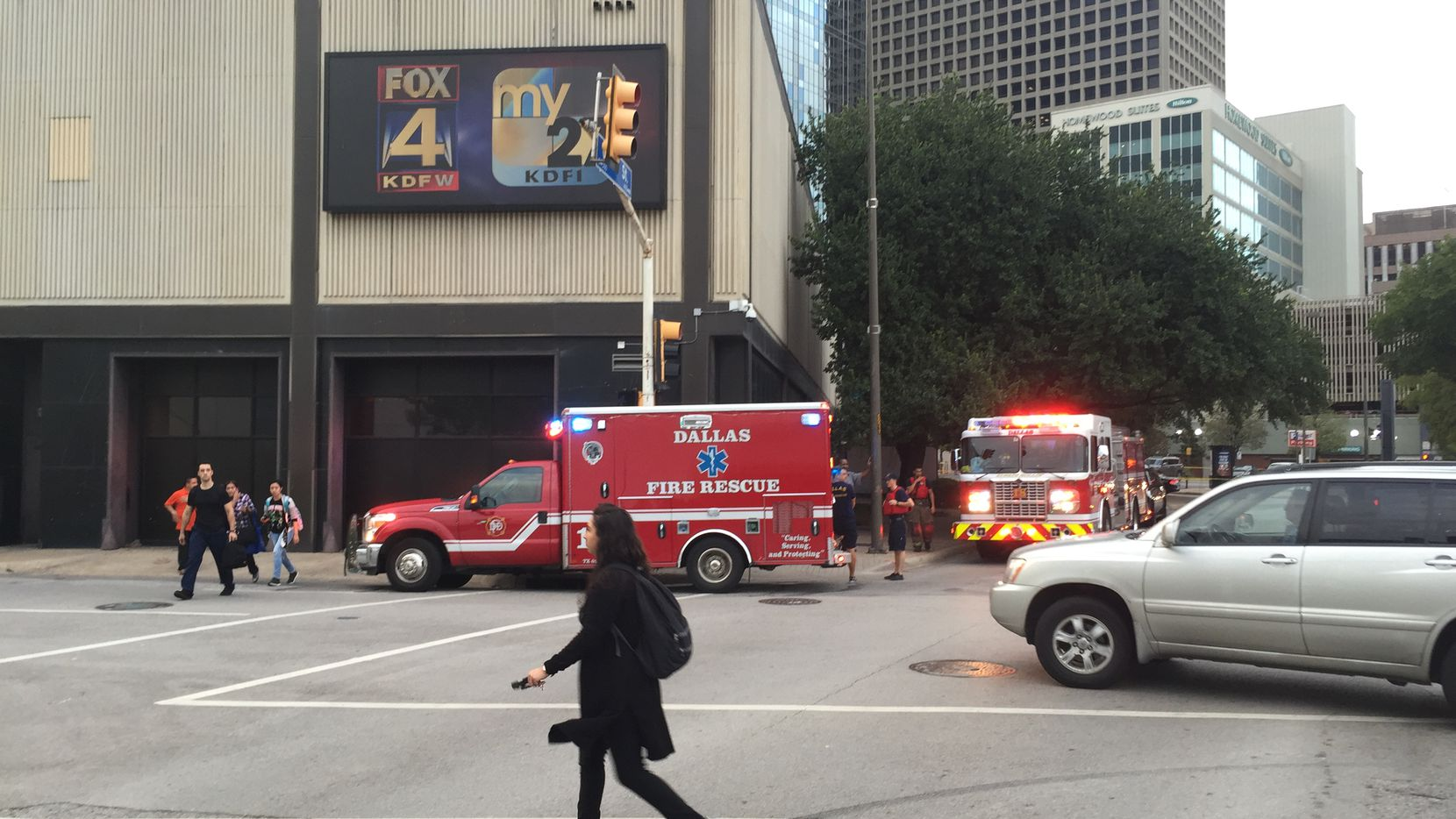 Dallas Fire-Rescue vehicles sit outside the KDFW-TV studio in downtown Dallas on Wednesday after a man intentionally crashed his pickup into the building, police said.