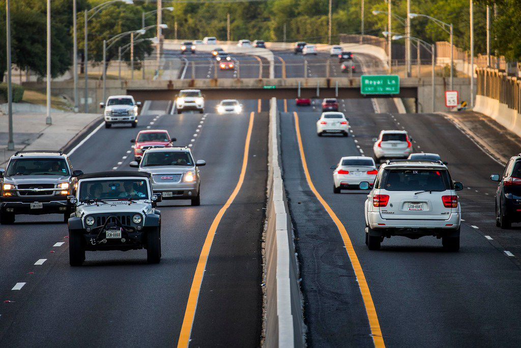 Traffic is seen flowing on the Dallas North Tollway looking north from the bridge on Walnut Hill Lane on Tuesday, Aug. 7, 2018, in Dallas.