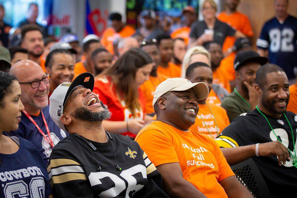 Adrian Matute (left) laughs the meeting on Sept. 6.
