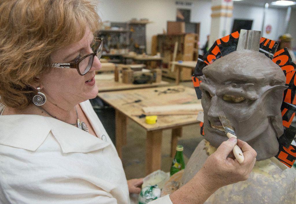 Kris Anderson, president of the Dallas Makerspace and an avid cosplayer, works on a mask of the Gargoyles€ character Goliath during an open house in Carrollton.