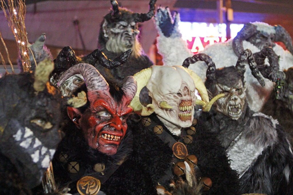 Krampus characters pose for a photograph before the Dallas Krampus Walk through the streets of Deep Ellum, organized by the Krampus Society and Dark Hour Haunted House, on Friday, Dec. 5, 2014.