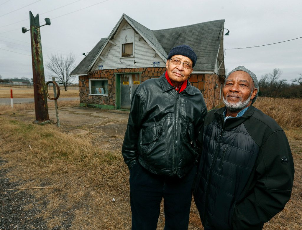 The Rev. Allen Threatt III (left) and his cousin Edward Threatt stand outside the Threatt Filling Station in Luther, Okla. The station is on the National Register of Historic Places for its distinction as a black-owned filling station along Route 66.