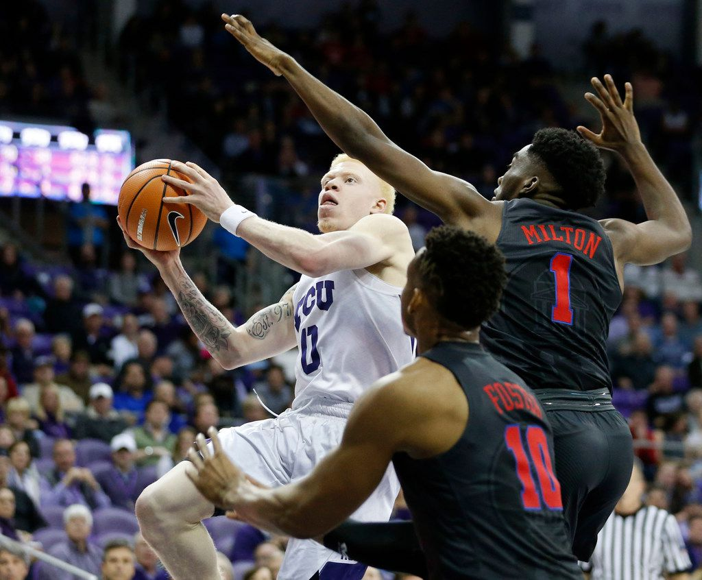TCU Horned Frogs guard Jaylen Fisher (0) drives to the basket as Southern Methodist Mustangs guard Shake Milton (1) and Southern Methodist Mustangs guard Jarrey Foster (10) defend during the second half of play at Schollmaier Arena at TCU in Fort Worth, on Tuesday, December 5, 2017. TCU Horned Frogs defeated Southern Methodist Mustangs 94-83. (Vernon Bryant/The Dallas Morning News)