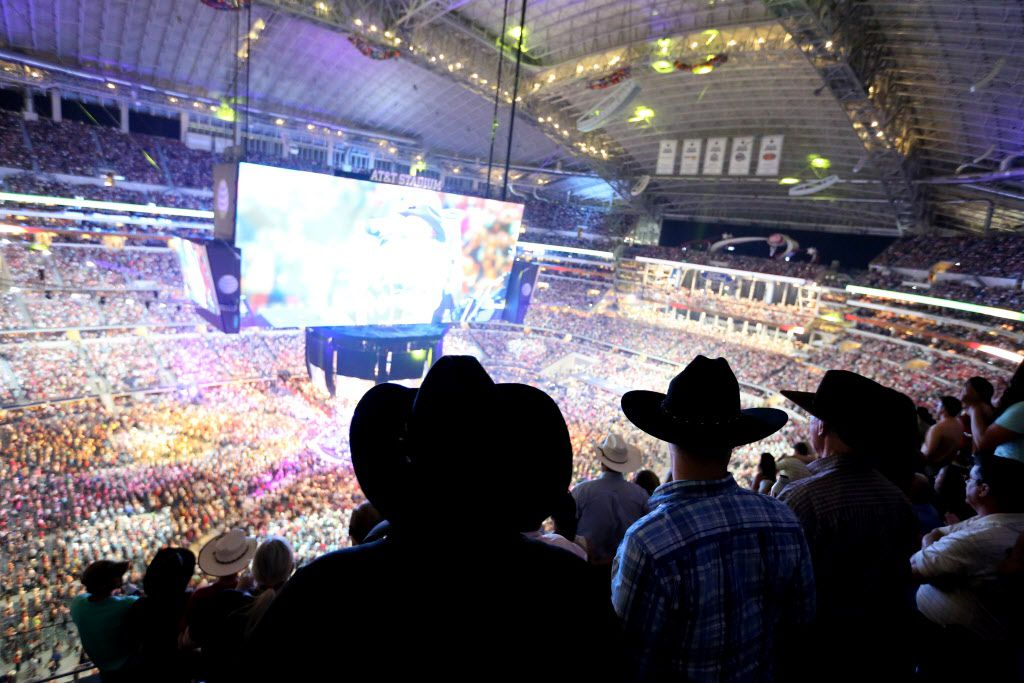Fans watch the closing numbers as George Strait plays the last show of his final tour at AT&T Stadium in Arlington, Texas on June 7, 2014.