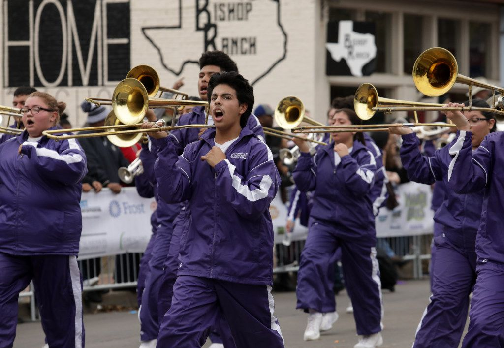 The Sunset High School marching band performs during the Oak Cliff Mardi Gras parade in 2017.