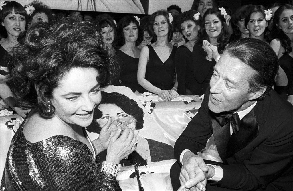 Halston, the fashion designer, with Elizabeth Taylor and the Rockettes at her birthday party at Studio 54, 1978.