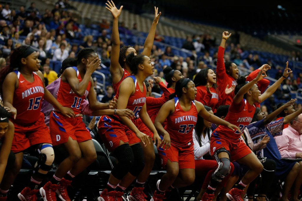 Duncanville bench celebrates as their teammates score against Houston Cypress Ranch during the Class 6A girls basketball UIL state final at the Alamodome in San Antonio Saturday, March 4, 2017. (Stephen Spillman/Special Contributor)